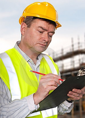 construction-foreman-checks-clipboard-16722700